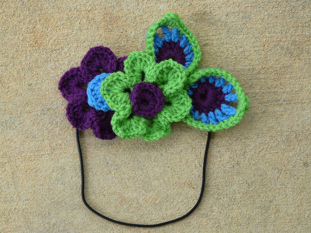 headband with crochet flowers and crochet feathers