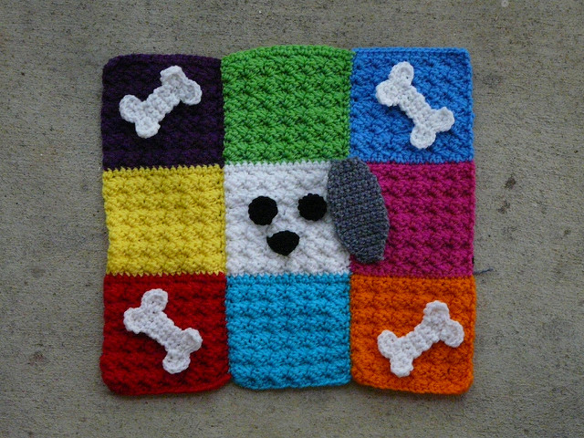 crochet pet mat with a dog's face at the center