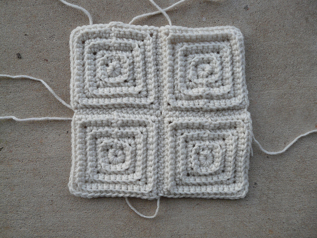 four textured squares joined into one textured crochet square
