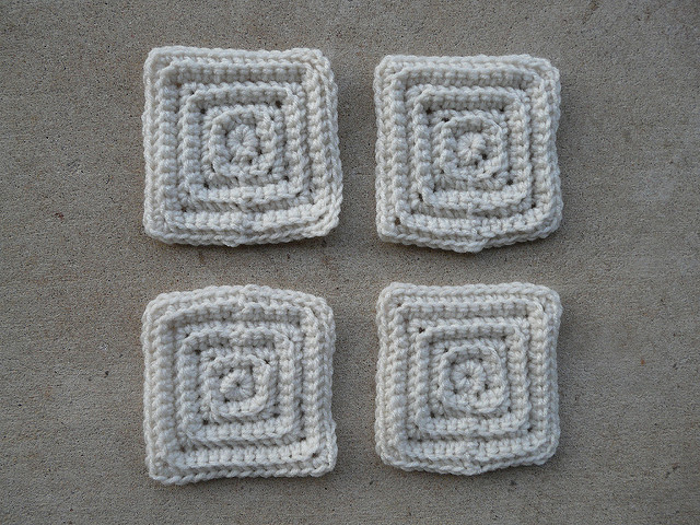 four small textured crochet squares