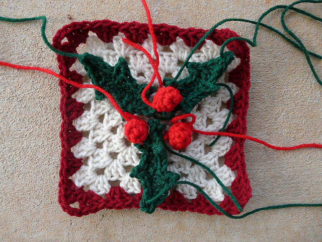 crochet square with crochet leaves and crochet berries