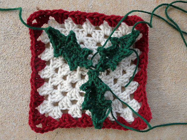 crochet square with crochet leaves