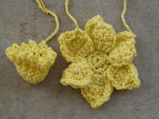 The petals and trumpet of a crochet daffodil