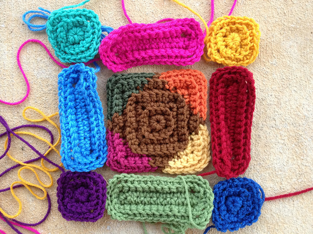Laying out the pieces for the multi-color crochet motif