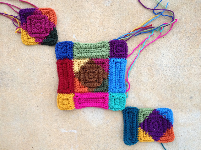 three multicolor crochet squares