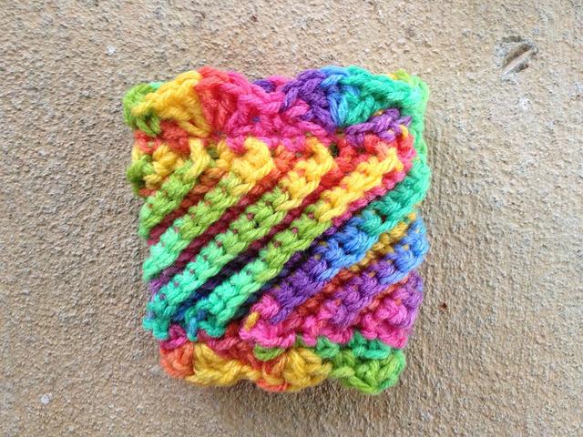 psychedelic crochet coffee cozy