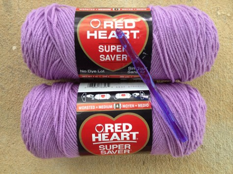 Two skeins of Red Heart Super Saver orchid and a coordinating hook