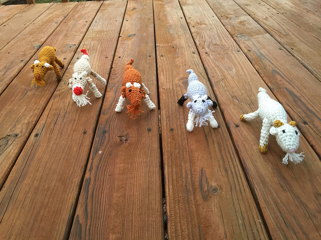Five amigurumi goats race