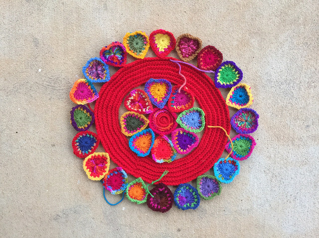 crochet hearts around a crochet ring