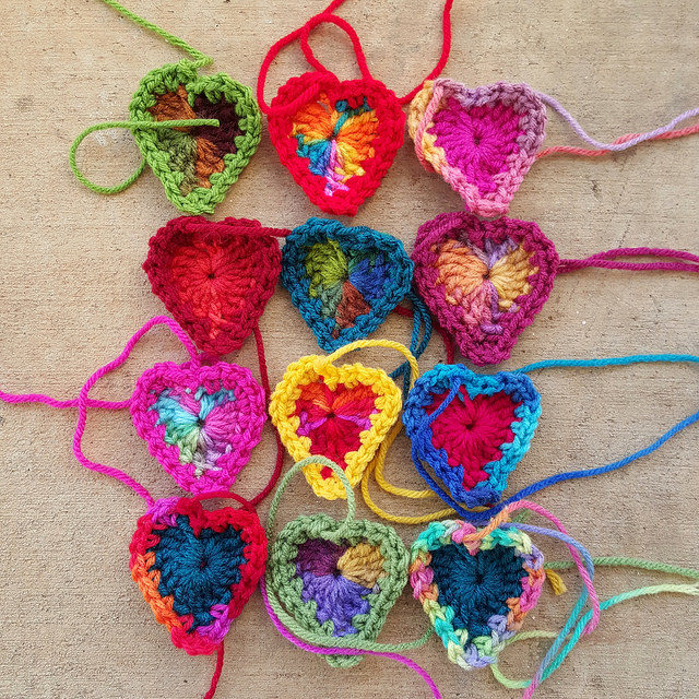 a dozen boho crochet hearts