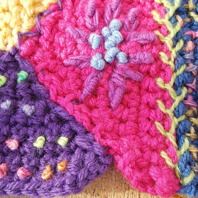 A seam of two crochet pieces in need of some embroidery to trick it out