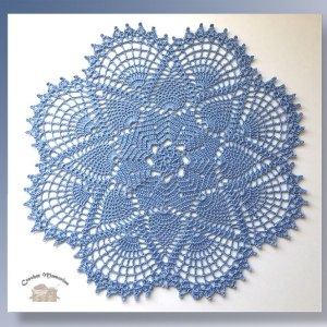 Blue Clouds Doily - Crochet pattern for a lacy pineapple doily - CrochetMemories.com