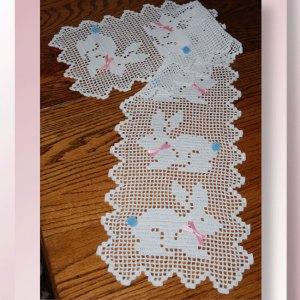 Hippety Hoppety Easter Bunny Runner - Crochet pattern for an Easter table runner depicting bunnies - CrochetMemories.com