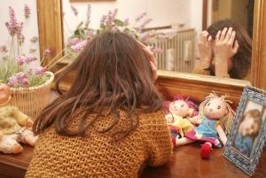 Foto figlio sui social: sanzione fino a 10mila euro per il genitore