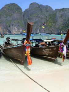 Boats on the beach at Phuket Thailand