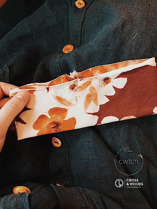Detail close up of family fabrics against black hinterland dress