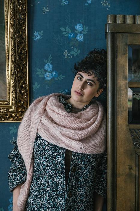 White woman modeling a pink shawl of Laine Publishing - 52 Weeks of Shawls