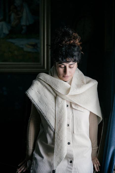 White woman modeling a white shawl of Laine Publishing - 52 Weeks of Shawls