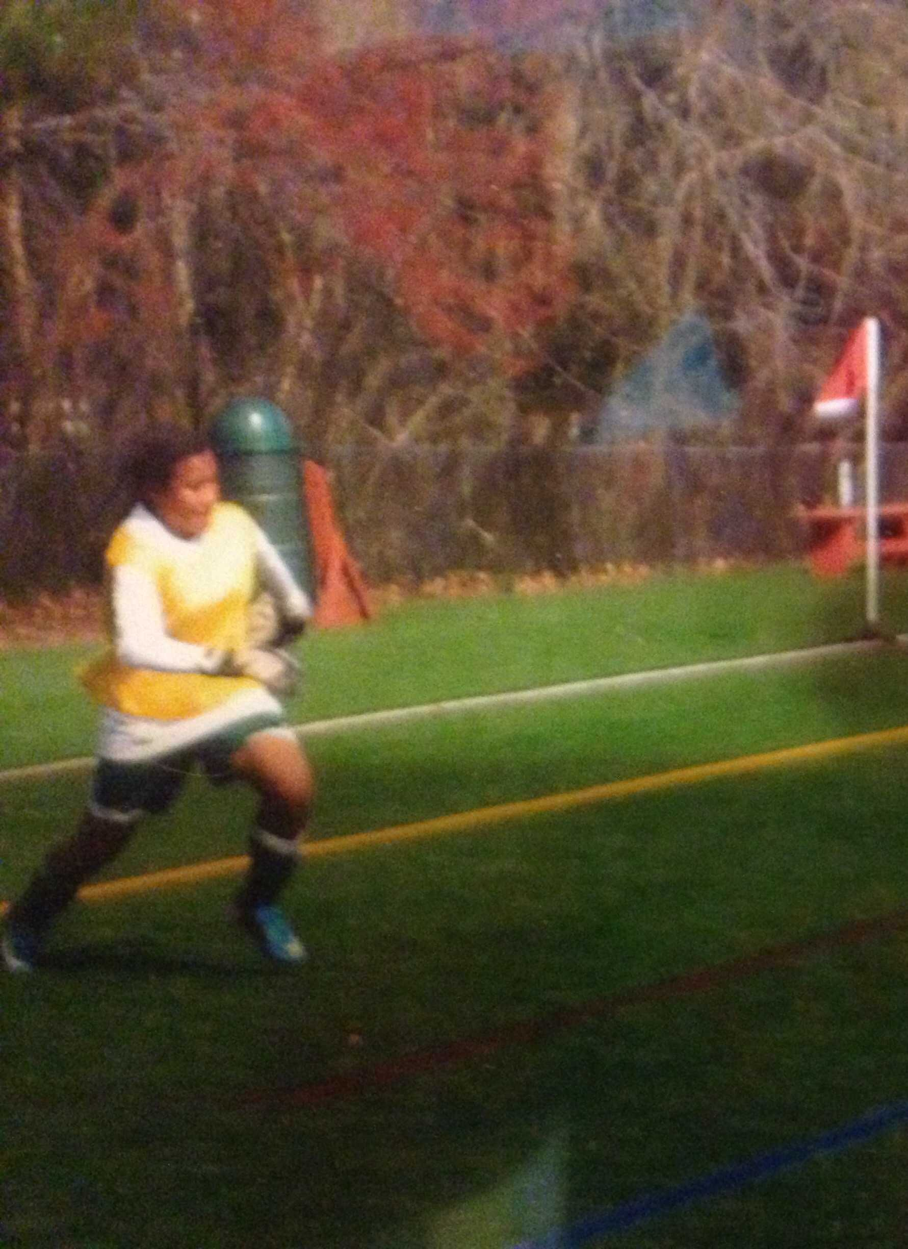 Soccer player Cayla White playing her favorite position, goalie.