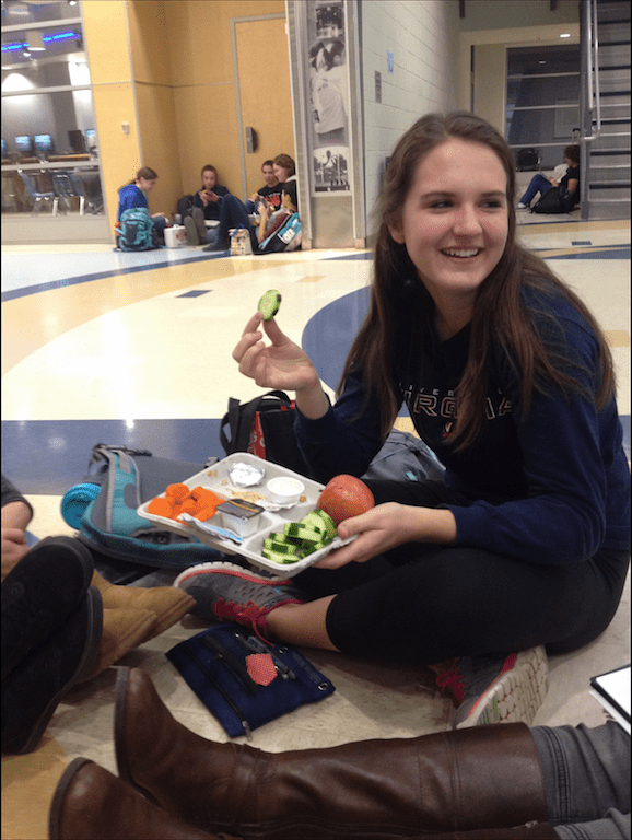 Sophomore+Cara+Ford+enjoys+her+lunch+of+a+chicken+sandwich%2C+cucumbers%2C+an+apple+and+milk+while+talking+to+her+friends