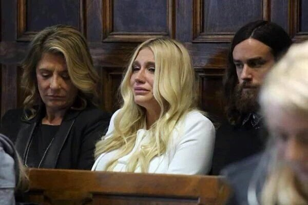 Singer and songwriter Kesha sits in the back of courtroom as Justice Shirley Kornreich rules against her.