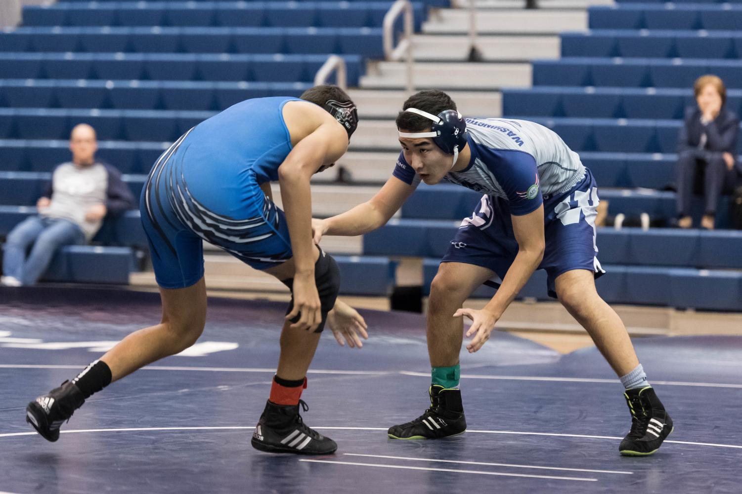 Senior Temmulen Jargalsaikhan focuses on pinning his opponent