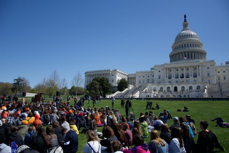 Students+gather+at+the+Capitol+Building+to+watch+a+host+of+student+speakers+talk+about+gun+control.