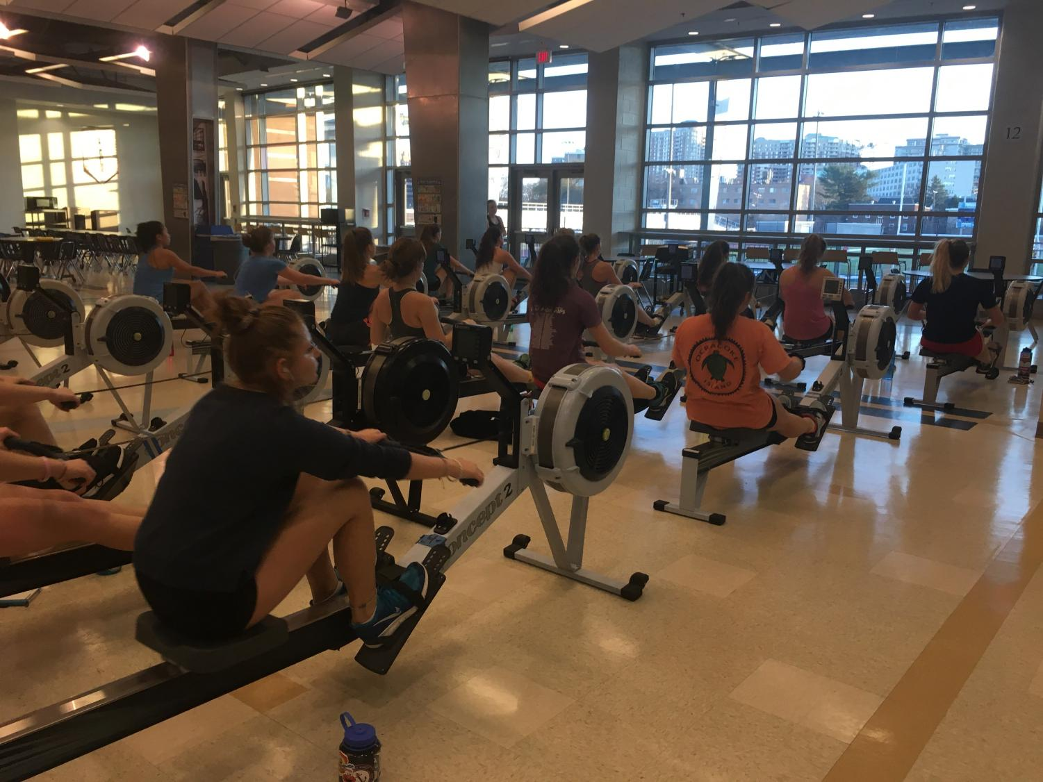 Hard at work, the girls crew team practices rowing on machines called ergometers. The crew team must raise close to 700 dollars per person in funds.