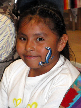 A young Hopi girl who loved the face painting plus she got to go to a hike to one of her ancestral prehistoric sites in the area.