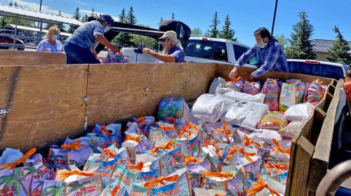 Hopis and Crossing Worlds volunteers transferring groceries and hygiene supplies to Hopi trailer at Flagstaff, July 6, 2020.