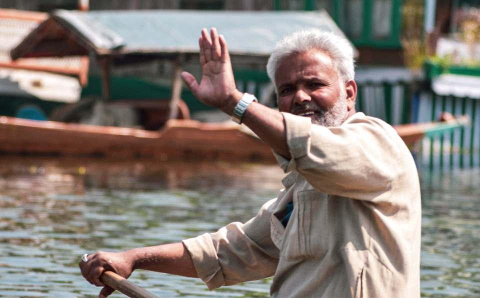 local people waving at dal lake Srinagar
