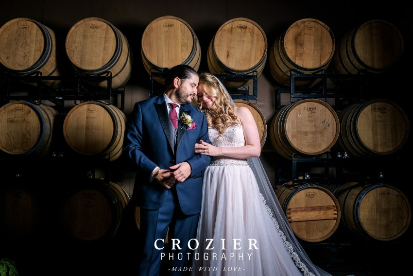 JM Cellars fall wedding photo in barrel room
