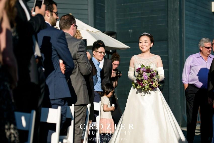 Bride walking down the aisle at the Seattle Aquarium