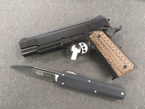 Not the John Wick knife, but it is the 1911 he used in the