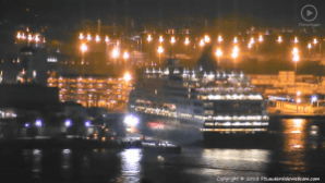 Ambulance lights reflect off of Maasdam's hull in Port Everglades.