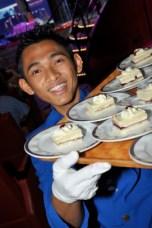 One of HAL's enthusiastic waiters aboard Nieuw Amsterdam.