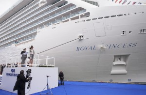 The bottle breaking on the Royal Princess' hull.