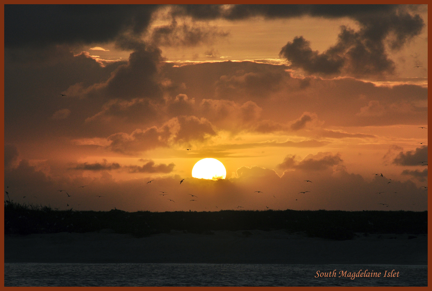 magdalaine south cay sunset