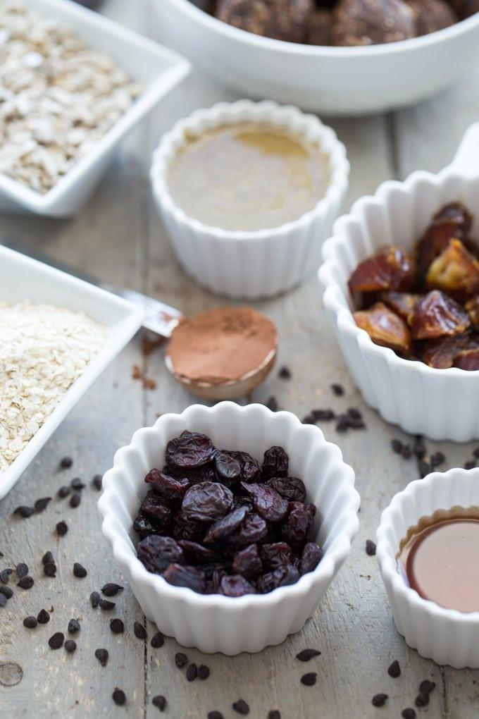 Ingredients to make Dark Chocolate Cherry Energy Bites arranged individual dishes.