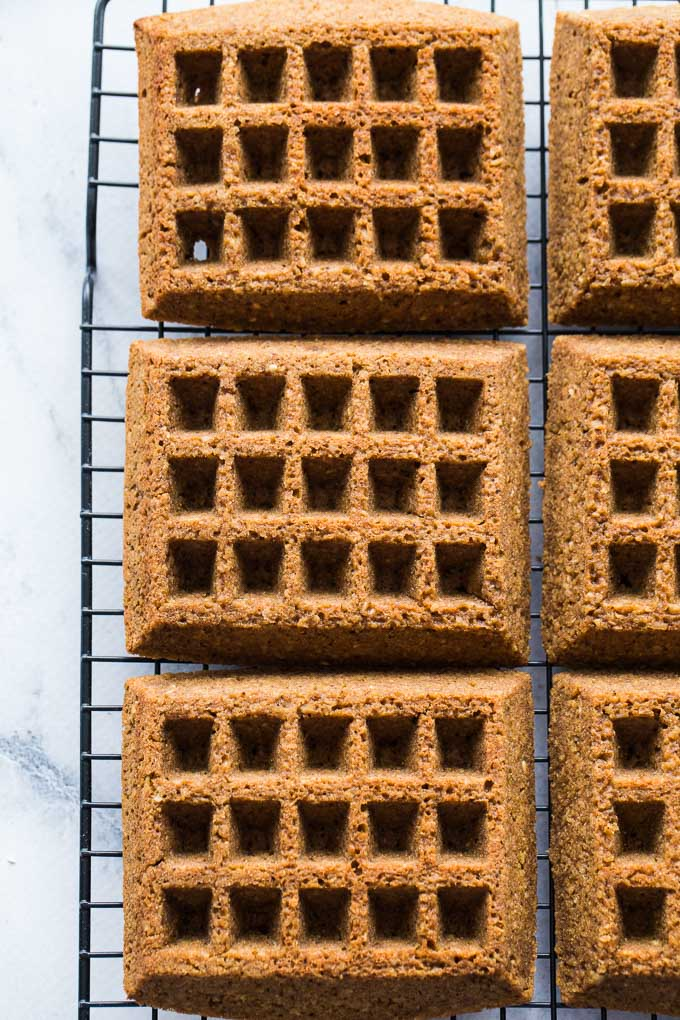 Overhead view of Gingerbread Waffles cooling on a wire rack.