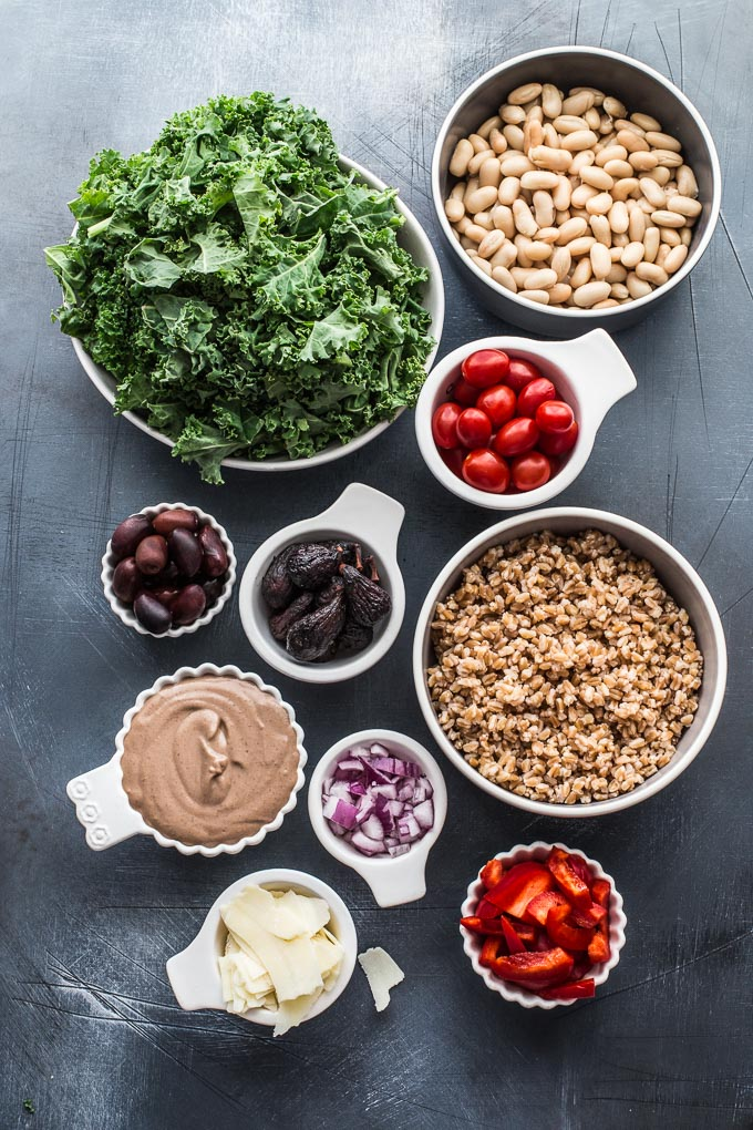 Overhead view of ingredients to make Tuscan Salad with Farro and Fig Tahini Dressing.