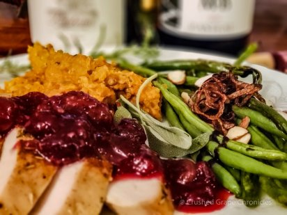 Smoked roasted turkey breast with a berry sauce, roasted mashed sweet potatoes with herbs de provençe and sauteed green beans with fried shallots, almonds & balsamic reduction.