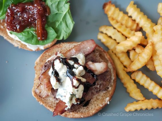 Burger with bacon, blue cheese, balsamic reduction, spinach and tomato marmalade, & fries