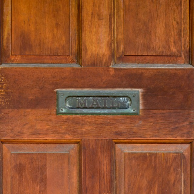 Rich brown door with old style mail slot