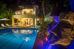 Discovery Beach House moai and pool at night