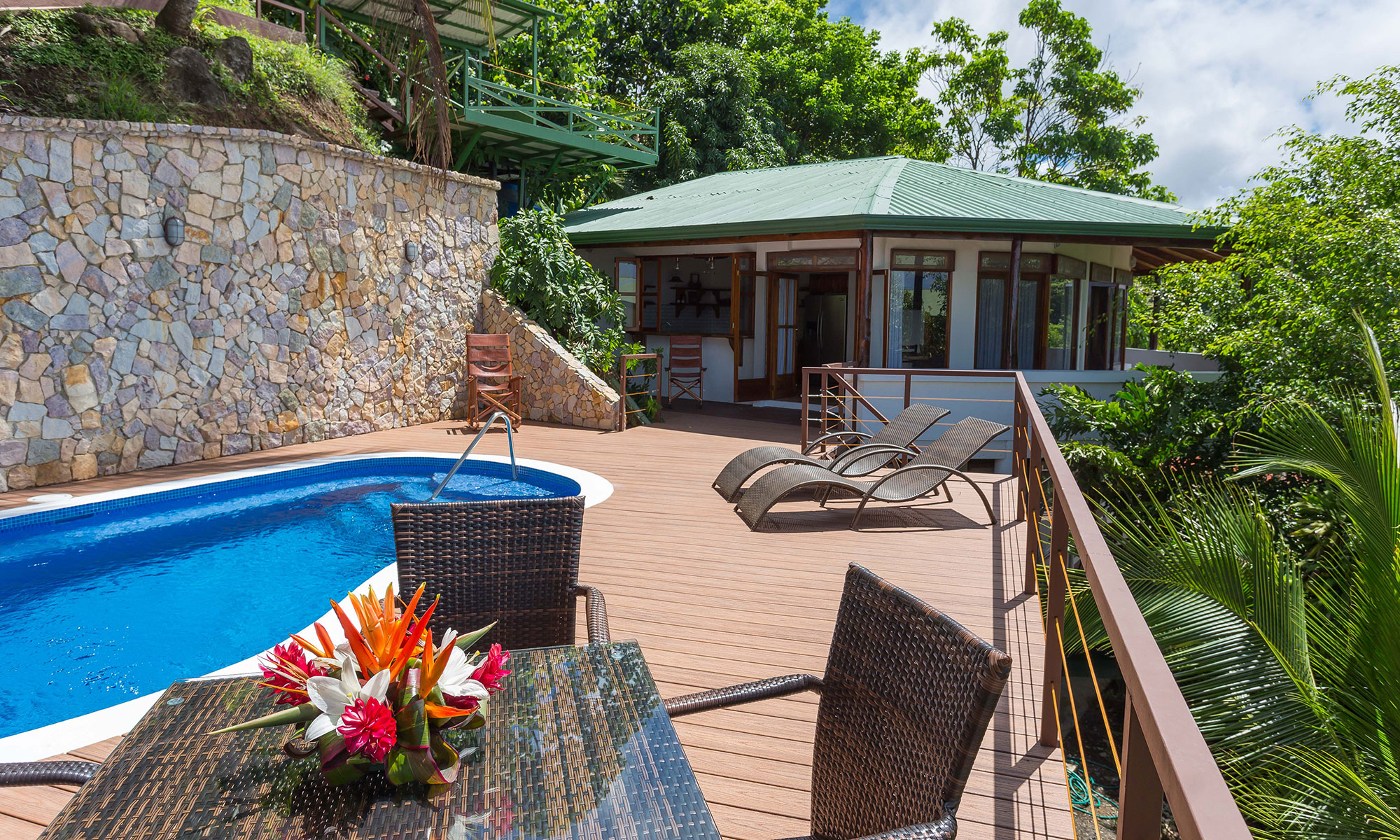 Villa Natura pool, deck, and house