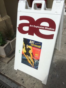 Sign in front of Art Explosion and poster for 2014 show