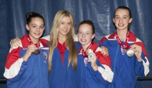 Louise Bradley, Florence Smith, Ciara McGing, Coach Chelsea
