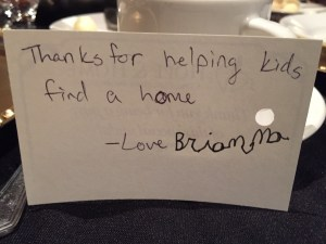 "Message on a folded index card in child scrawl reads, ""Thanks for helping kids find a home.--Love Brianna"""