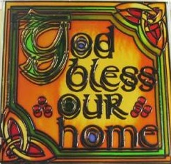 "Stained glass orange and green magnet with Celtic chain designs in two corners says ""God bless our home."""
